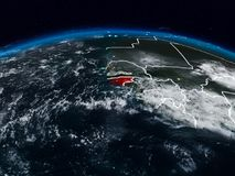 Guinea-Bissau at night. Guinea-Bissau from space at night on Earth with visible country borders. 3D illustration. Elements of this image furnished by NASA royalty free stock photos