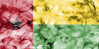Guinea Bissau smoke flag isolated on a white background. Guinea Bissau smoke flag isolated on a white background Stock Images