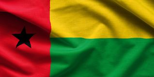 Guinea Bissau Waving Flag. Close up fabric background stock photography