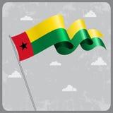 Guinea-Bissau wavy flag. Vector illustration. Royalty Free Stock Images