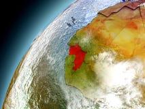 Guinea de la órbita de Earth modelo Foto de archivo libre de regalías