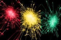 Guinea fireworks sparkling flag. New Year, Christmas and National day concept.  stock photos
