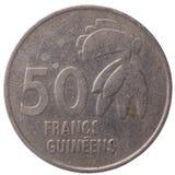 50-Guinea-Franc-Münze, 1994, hinter Lizenzfreie Stockbilder