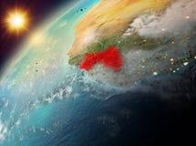 Guinea op aarde in zonsondergang Stock Fotografie
