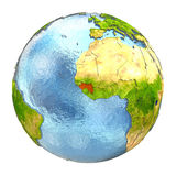 Guinea in red on full Earth. Guinea highlighted in red on Earth. 3D illustration with highly detailed realistic planet surface isolated on white background royalty free illustration