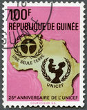 GUINEA - 1971: shows UNICEF Emblem, Map of Africa, series 25th anniversary Stock Photo