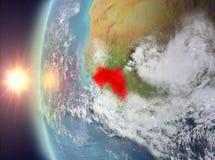 Guinea tijdens zonsondergang van ruimte Royalty-vrije Stock Afbeelding