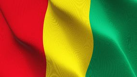 Guinea flag waving on wind. Guinean background fullscreen flag blowing on wind. Realistic fabric texture on windy day Royalty Free Stock Photo