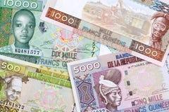 Guineanska pengar en affärsbakgrund royaltyfria bilder