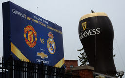 Guiness balloon and Champions Cup sign in Ann Arbor. ANN ARBOR, MI - AUGUST 2:  The Guiness balloon and International Champions Cup sign at Michigan Stadium at Stock Photo