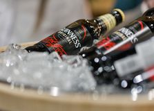 Whisky Dram Festival in Kiev, Ukraine. Guiness beer bottles closeup in a wooden bucket at 3rd Ukrainian Whisky Dram Festival in Parkovy Exhibition Center Stock Photography