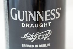 Guiness draught beer can closeup against white Royalty Free Stock Photo