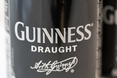 Guiness draught beer can closeup against white Stock Photo