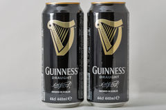 Guiness draught beer cans closeup against white Royalty Free Stock Photos