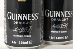 Guiness draught beer cans closeup against white Royalty Free Stock Images