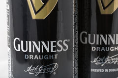 Guiness draught beer cans closeup against white Stock Photo