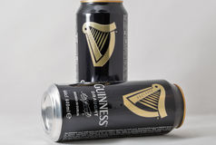 Guiness draught beer cans closeup against white Royalty Free Stock Image