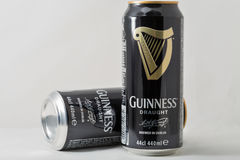 Guiness draught beer cans closeup against white Royalty Free Stock Photo