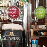 Guiness and wine beertaps Royalty Free Stock Photo