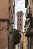 Guinigi tower in Lucca, Italy, with trees on the top Stock Photos