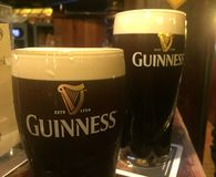 Guinness beer. Berlin, Germany - November 24, 2017: glasses of Guinness beer. Guinness is an Irish dry stout that originated in the brewery of Arthur Guinness at royalty free stock image