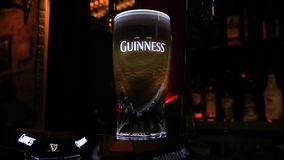 Guinness beer foam dance in bar stock video footage