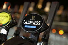 GUINNESS BEER PUMP IN BAR Stock Photos