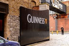 Guinness Brewery, Ireland. DUBLIN, IRELAND - JULY 12, 2016: Guinnes logo on the entrance gate to the  Brewery. Guinness is an Irish dry stout produced by Diageo Royalty Free Stock Photo