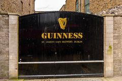 Guinness Brewery, Ireland. DUBLIN, IRELAND - JULY 12, 2016: Guinnes logo on the entrance gate to the  Brewery. Guinness is an Irish dry stout produced by Diageo Royalty Free Stock Photos