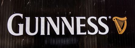 Guinness Brewery, Ireland. DUBLIN, IRELAND - JULY 12, 2016: Guinnes logo on the entrance gate to the  Brewery. Guinness is an Irish dry stout produced by Diageo Royalty Free Stock Photography
