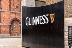 Guinness Brewery, Ireland. DUBLIN, IRELAND - JULY 12, 2016: Guinnes logo on the entrance gate to the  Brewery. Guinness is an Irish dry stout produced by Diageo Royalty Free Stock Images