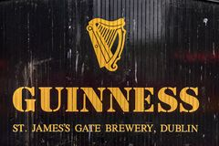 Guinness Brewery, Ireland. DUBLIN, IRELAND - JULY 12, 2016: Guinnes logo on the entrance gate to the Brewery. Guinness is an Irish dry stout produced by Diageo stock photo