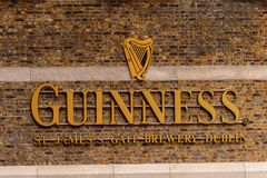 Guinness Brewery, Ireland. DUBLIN, IRELAND - JULY 12, 2016: Guinnes logo . Guinness is an Irish dry stout produced by Diageo originated in the brewery of Arthur Royalty Free Stock Photo