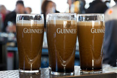 Guinness. DUBLIN, IRELAND - FEB 15, 2014: Pints of beer are served at the popular Guinness Brewery on Feb 15, 2014. The brewery where 2.5 million pints of stout royalty free stock photography