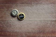 Guinness-Flaschenkapseln Stockfoto