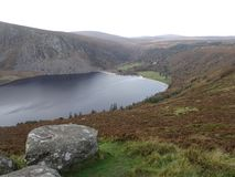 Guinness Lake - Lough Tay in Ireland in the Wicklow Mountains. Beautiful Lough Tay Guinness Lake in the Wicklow Mountains in Ireland. Location of the series stock photography