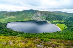 Guinness lake tay wicklow. The very picturesque Lough Tay in county Wicklow, Ireland. Also known as the Guinness lake, as it was owned by the Guinness family royalty free stock image
