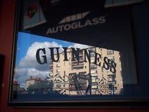 Guinness logo in reflection Stock Photos