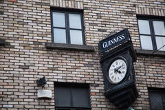 Guinness sign. Above clock in Dublin Royalty Free Stock Photo