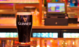 Guinness tap. Isolated in pub stock photo