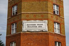 Guinness Trust. Guinness Trust Buildinggs 1802. The place where tourists can find the weirdest things. And an independent musician. London, Columbia road. 09.24 stock photography