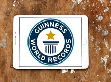 Guinness World Records logo. Logo of Guinness World Records on samsung tablet on wooden background. Guinness World Records is a reference book published annually royalty free stock images