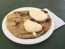 Guirilas Honduras traditional food cream and exotic chesse cuajada. On a plate honduras traditional food guirilas corn base tortillas with cuajada and cream stock image