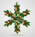 Guirlande à feuilles persistantes de Noël sous la forme de flocon de neige Images stock