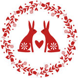 Guirlande avec des fleurs et des lapins Image libre de droits