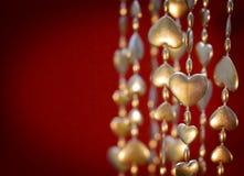 Guirlande de coeur d'or du jour de Valentine Photos stock