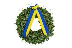 Guirlande de laurier avec un ruban jaune-bleu commémoratif Photo stock