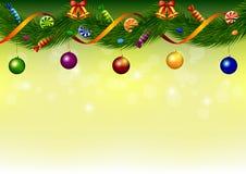 Guirlande de Noël avec des bonbons, des cloches et des boules Image stock