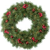 Guirlande de Noël avec les baies et les babioles rouges Photos stock