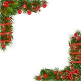 Guirlande de Noël avec les décorations rouges Photographie stock libre de droits